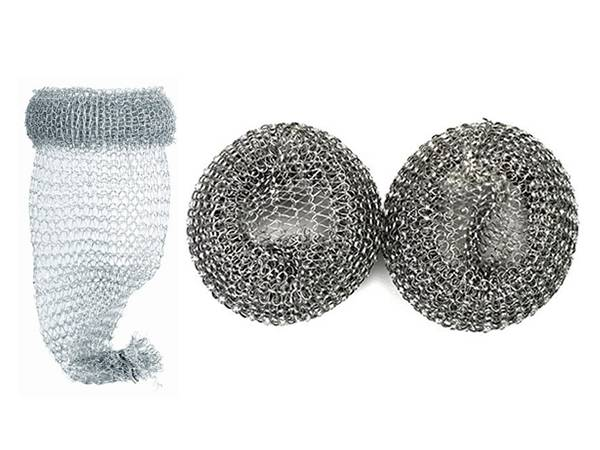 Three aluminum mesh washing machine lint traps, one unfolded and two folded.