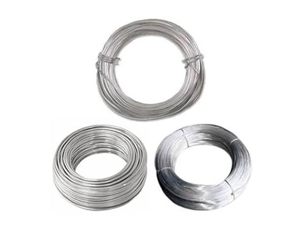 Three coils of aluminum wire on the white background.