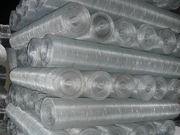 Aluminum woven wire mesh rolls in warehouse