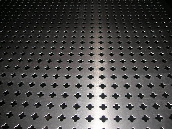 Perforated aluminum metal sheet with crosswise holes in straight rows